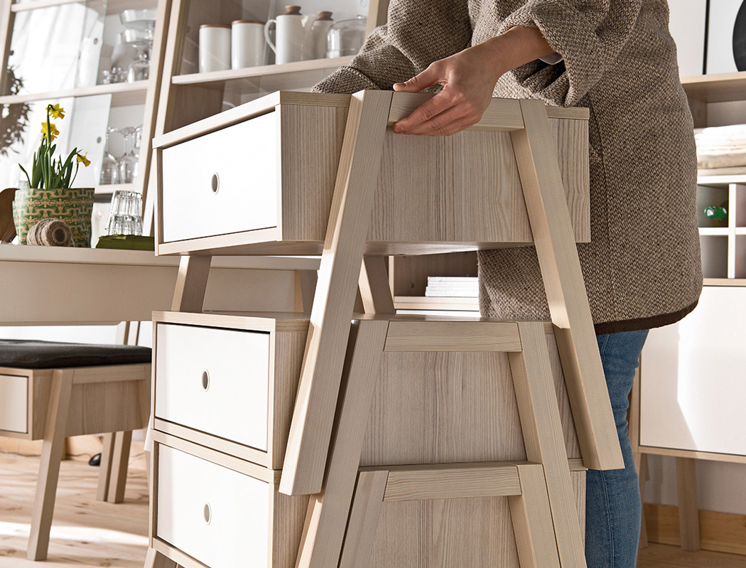 04-The-furniture-is-modular-stackable-and-is-made-of-blond-wood