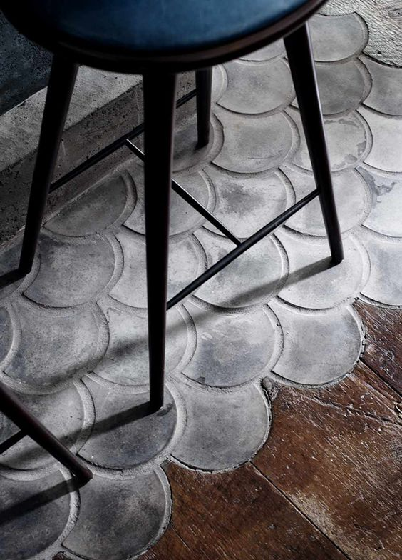 05-Fish-scale-scallops-in-concrete-mingle-with-wood-flooring