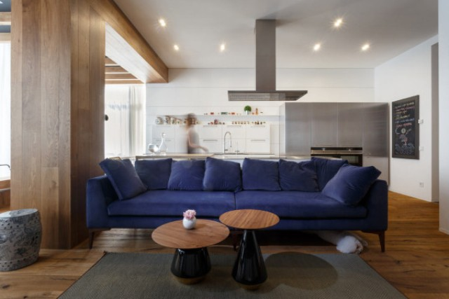 05-The-rich-blue-sofa-grounds-the-open-living-space