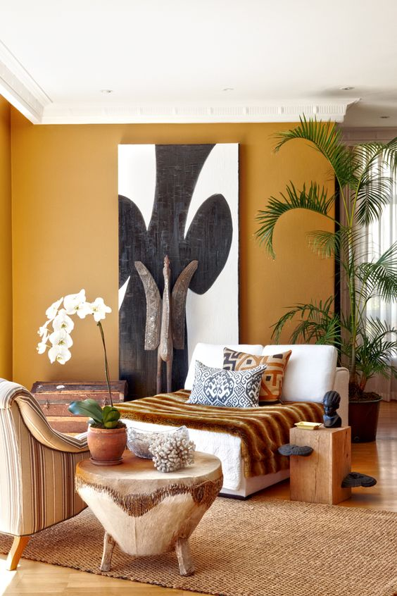 06-Shades-of-ocher-carvings-of-wood-and-the-artworks-make-this-living-room-terrific