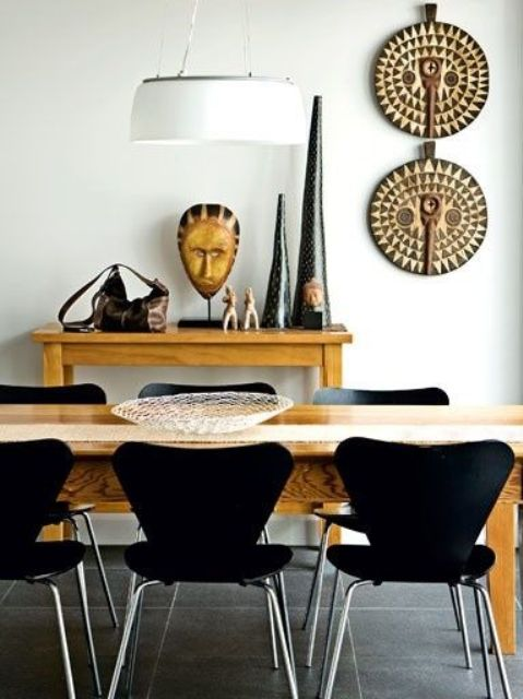 07-Chic-ethnic-dining-room-design-with-ocher-colored-furniture-and-African-pottery
