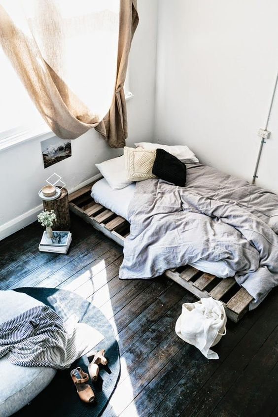 07-dark-shabby-wooden-floors-are-in-the-center-of-attention-in-this-simple-bedroom
