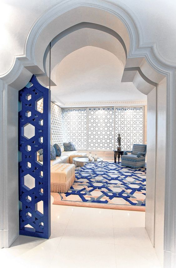 07-thick-doorway-with-a-Moroccan-arch-and-blue-styled-door