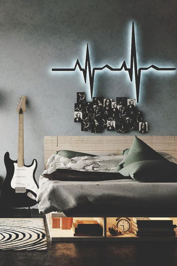09-music-fan-sleeping-area-decorated-with-photos-and-a-heartbeat-lighting