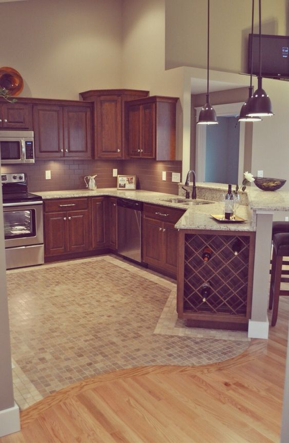 11-Curved-switch-between-wooden-and-mosaic-tiles-floor-in-the-kitchen