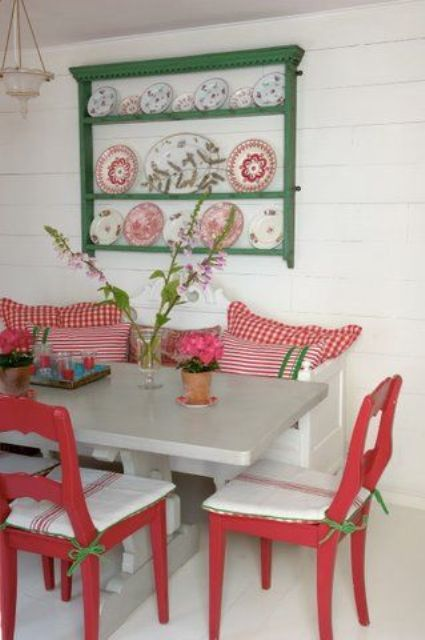11-Glossy-red-and-green-dining-area-in-a-summer-house