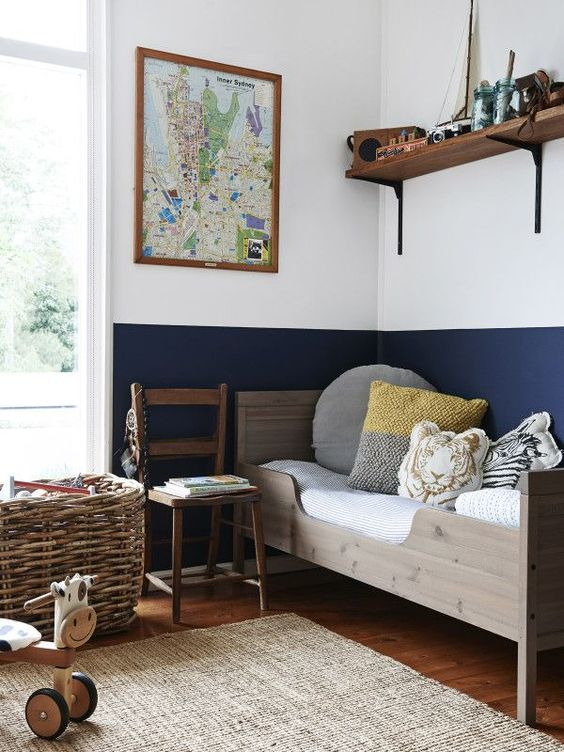 11-comfy-wooden-bed-and-open-shelving-with-favorite-toys-above-it