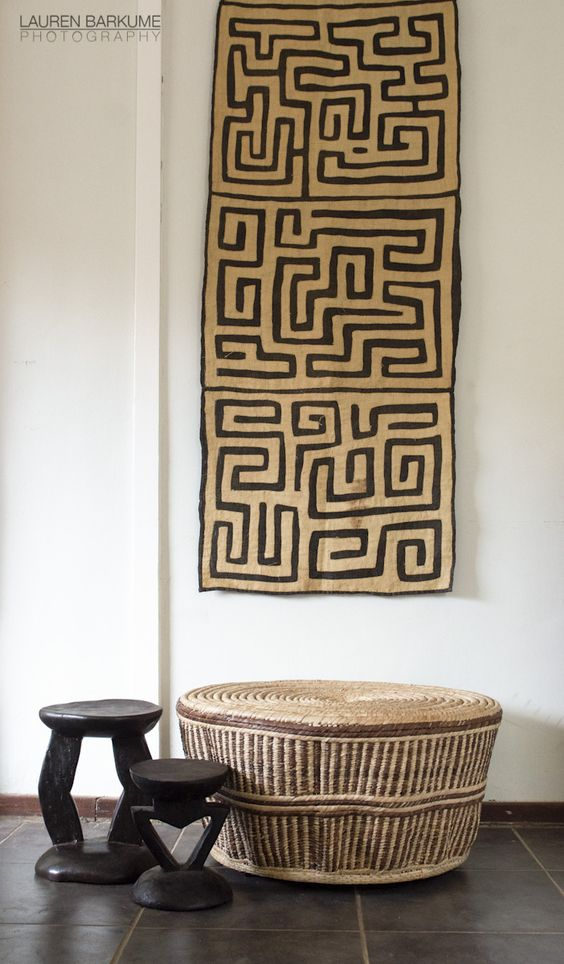 12-A-woven-table-and-wooden-stools-amde-by-African-artisans-and-the-Kuba-cloth