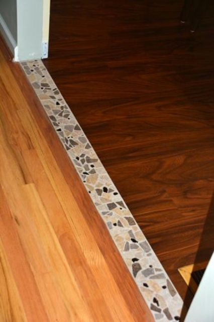 12-Accent-tile-transition-between-the-hardwood-in-the-dining-room-and-the-vinyl-planking-in-the-kitchen