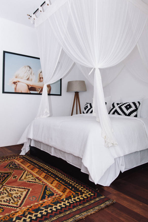 12-Another-bedroom-is-smaller-but-the-airy-canopy-makes-the-bed-very-inviting