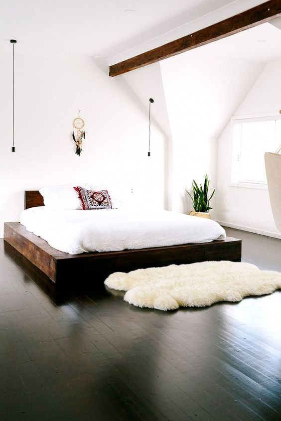12-polished-black-wood-floors-for-an-all-white-bedroom