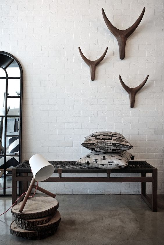 13-Dark-wood-bench-with-a-woven-seat-and-ethnic-pillows