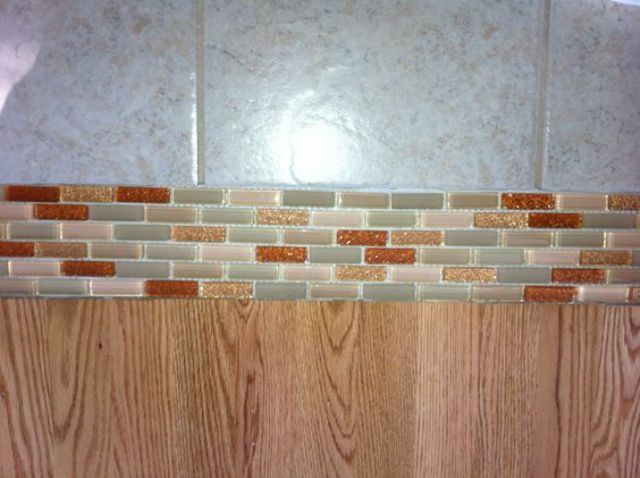 13-Glass-tile-transition-between-floors-instead-of-wood-or-marble