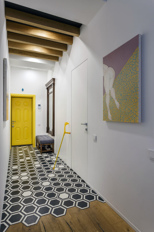 13-The-hallway-is-bold-and-colorful-with-creative-geo-tiles-and-the-owners-art-piece