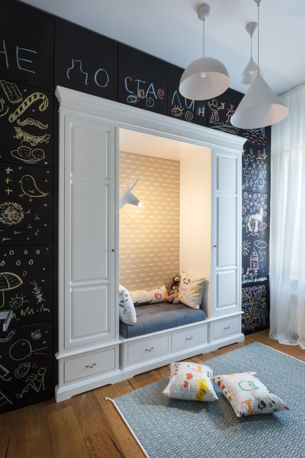 15-A-cozy-reading-nook-for-the-kid-is-inserted-into-a-chalkboard-wall-which-hides-cabinets