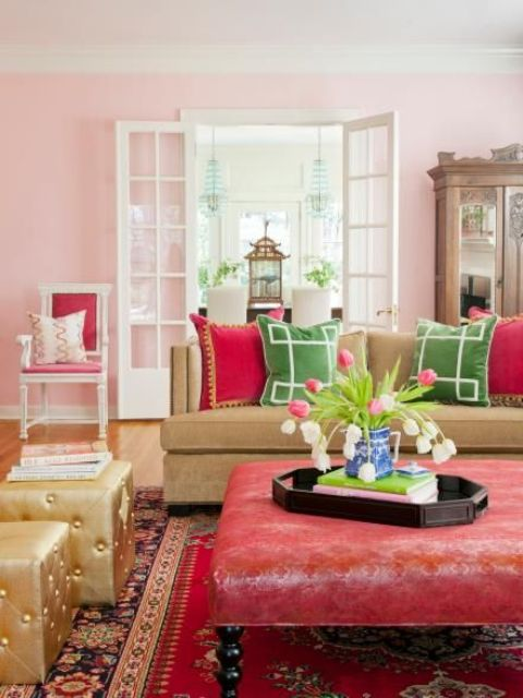 15-Pink-fuchsia-red-and-green-are-grounded-by-the-honeyed-tones-of-hardwoods-and-a-caramel-sofa