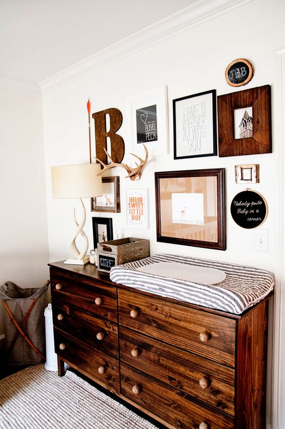 15-rustic-nursery-gallery-wall-and-changing-table-with-a-lot-of-drawers