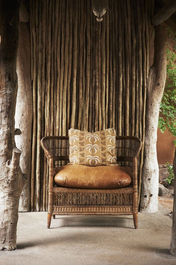 17-African-inspired-chair-of-rattan-and-leather-with-an-ethnic-pillow