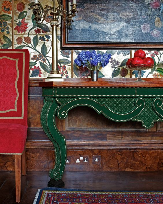 17-Red-upholstered-chair-and-an-emerald-console-table