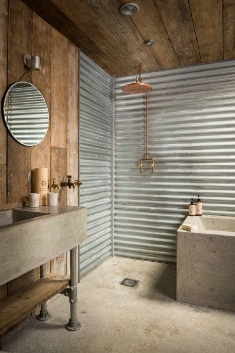 17-corrugated-metal-sheets-and-concrete-floors-for-a-rough-industrial-bathroom