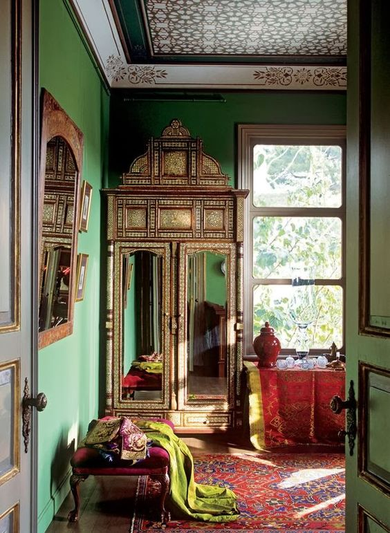 18-Moroccan-styled-interior-with-sage-green-walls-and-red-upholstered-furniture-and-textiles