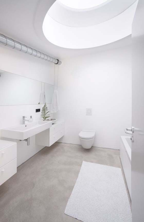 18-natural-concrete-floor-for-a-clean-all-white-bathroom