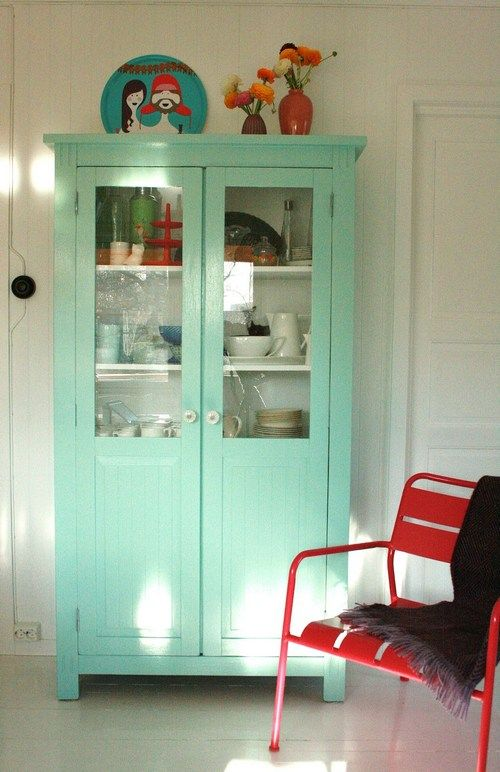 19-Neutral-interior-with-a-mint-cupboard-and-a-statement-red-chair