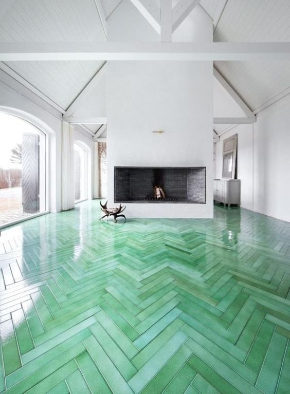 19-green-herringbone-wooden-floors-are-a-bold-decoration-feature-in-this-white-room