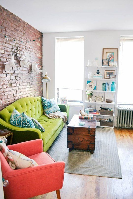 21-Neutral-living-room-with-a-bold-green-sofa-and-red-chair-that-stand-out