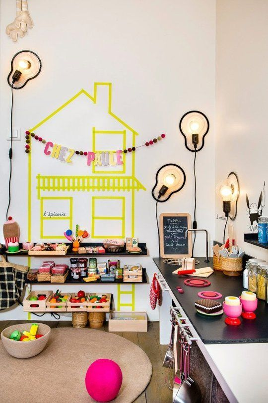 21-girls-play-area-with-a-play-kitchen-and-open-shelving-for-toys