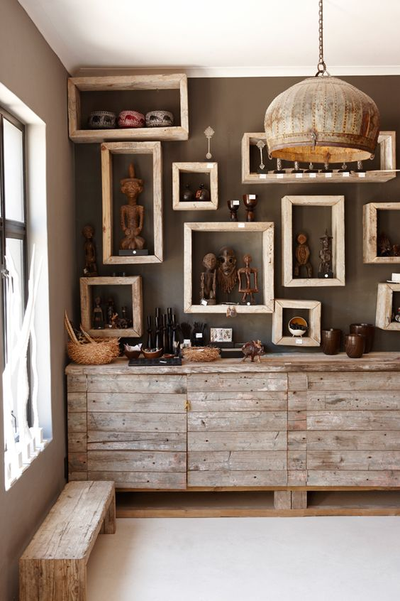 22-Namibian-statuettes-and-pottery-on-framed-shelves
