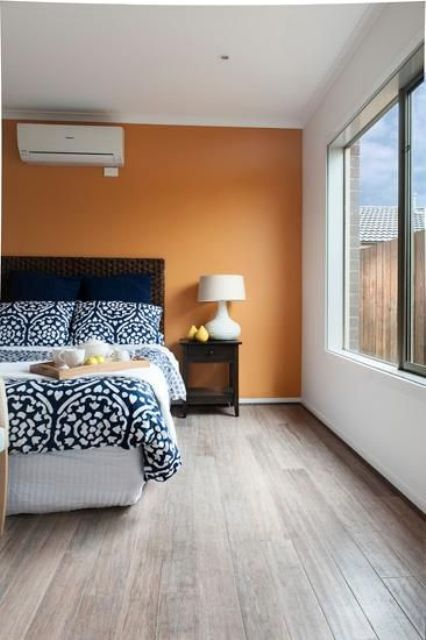 22-light-brown-flooring-soothes-the-orange-accent-wall