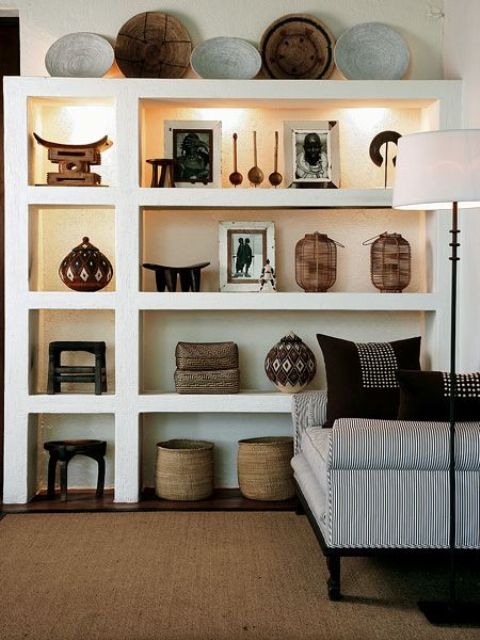 23-African-pottery-and-wooden-bowls-displayed-on-shelves-with-hidden-lights