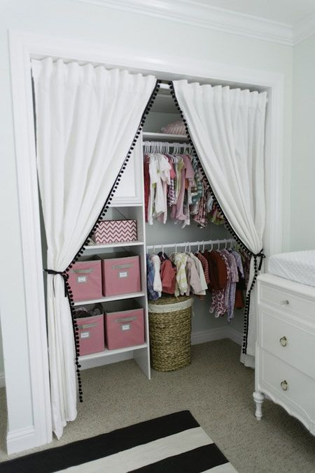 23-girls-nursery-closet-with-pompom-trim-curtains