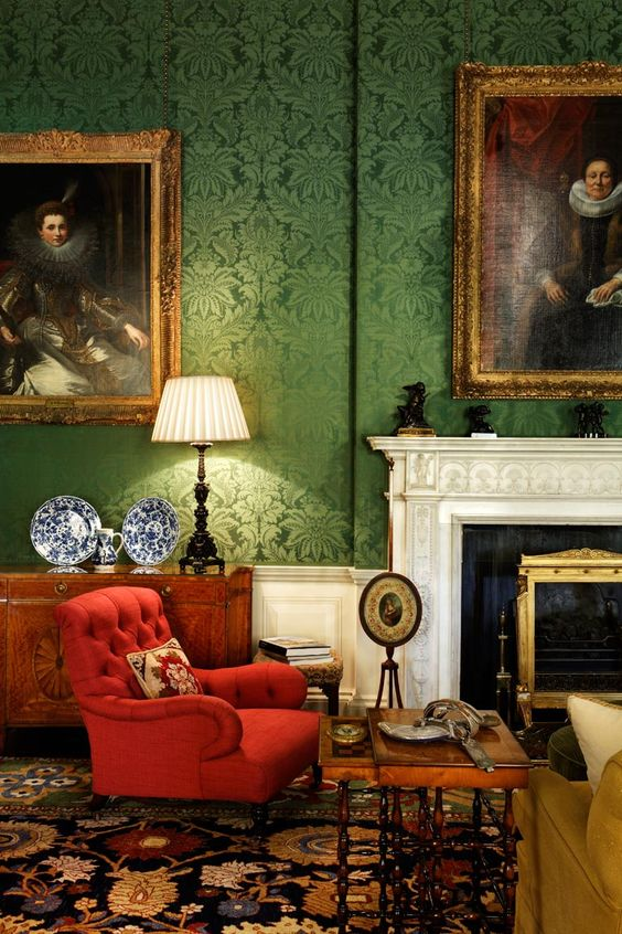 26-Green-damask-walls-and-a-red-tufted-chair