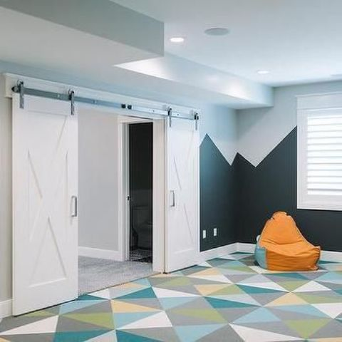 26-basement-playroom-with-bold-geometric-carpet-floors-which-make-falling-not-so-hurt