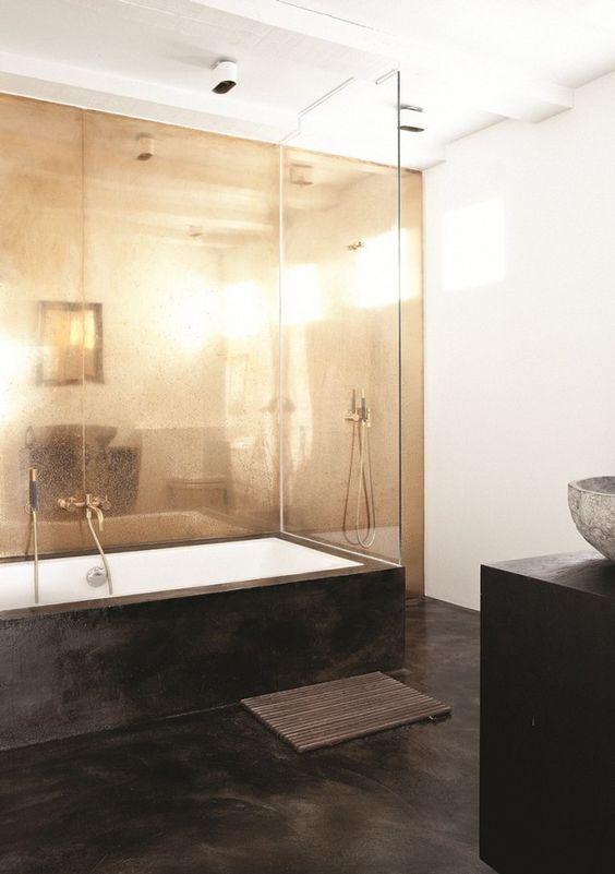 26-sleek-black-concrete-floors-to-contrast-with-a-brass-wall
