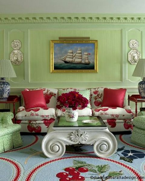 27-Soft-green-room-decor-accentuated-with-red-rugs-and-pillows