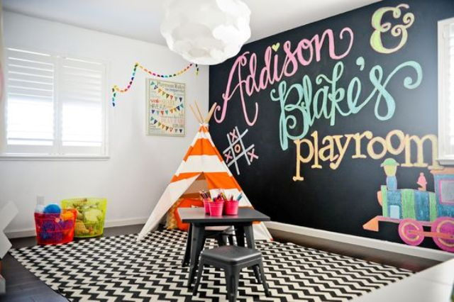 27-colorful-play-space-with-a-chalkboard-wall-a-teepee-and-a-desk