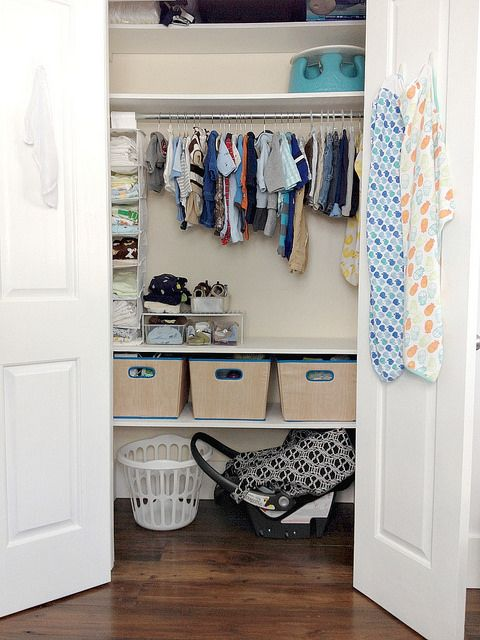 28-neat-closet-with-hangers-cubbies-and-plastic-shelving
