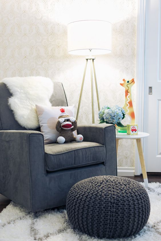 30-comfy-chair-with-a-knitted-ottoman-and-a-floor-lamp