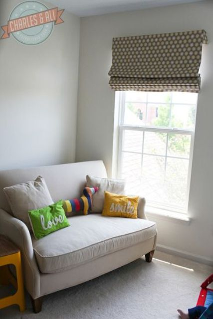 32-loveseat-with-pillows-in-a-baby-room