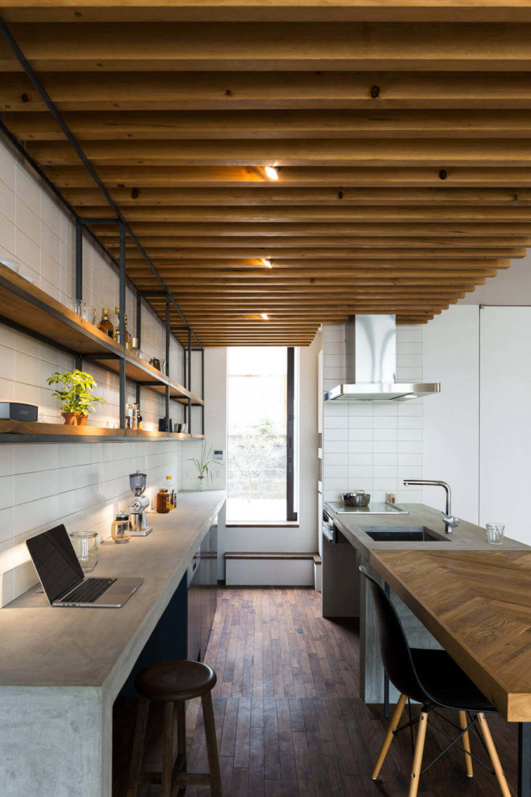 02-The-kitchen-is-decorated-with-concrete-and-warm-natural-woods-775x1163