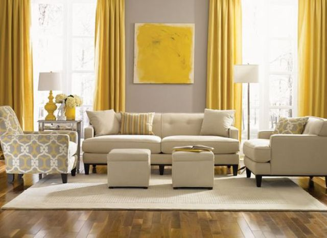 02-dove-grey-wall-contrasts-with-sunny-yellow-curtains-and-an-artwork-the-room-is-infused-with-cream-color-for-a-lighter-look