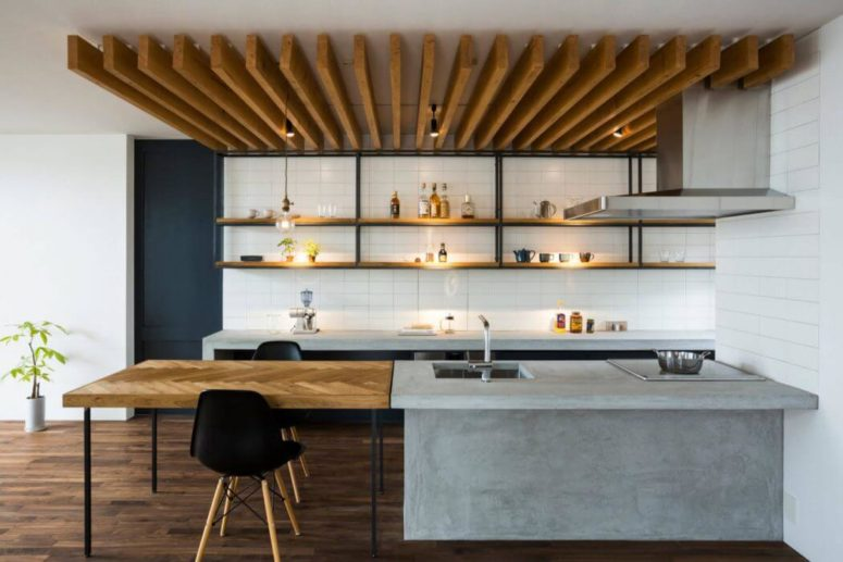 03-The-ceiling-is-decorated-with-wooden-planks-and-the-tabletop-is-clad-in-chevron-pattern-775x517