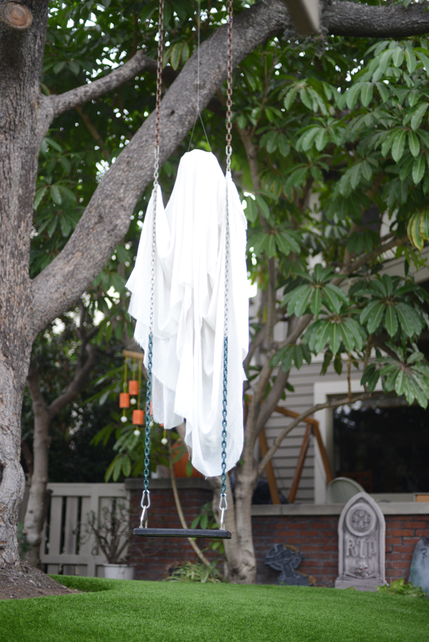 03-place-a-sheet-ghost-on-a-swing-in-your-backyard-to-get-a-cool-effect