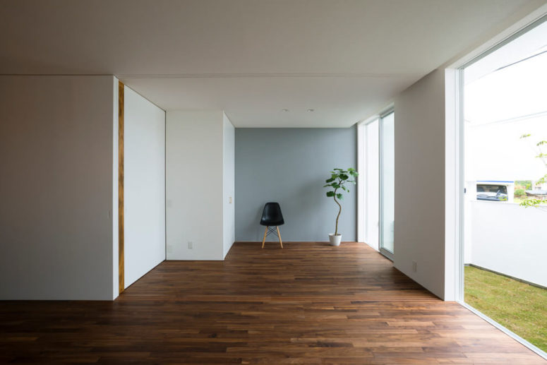 05-The-walls-are-white-and-beautiful-wood-clad-floors-make-the-space-more-interesting-775x517