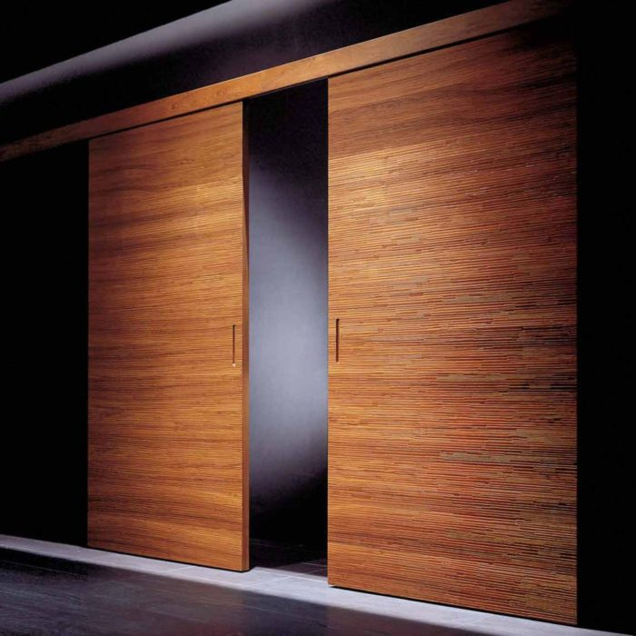 07-There-are-sliding-doors-for-larger-entrances-they-have-rich-wood-tones