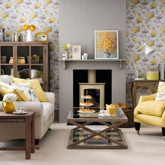 08-grey-and-yellow-floral-wallpaper-a-grey-fireplace-panel-and-a-yellow-chair-and-pillows