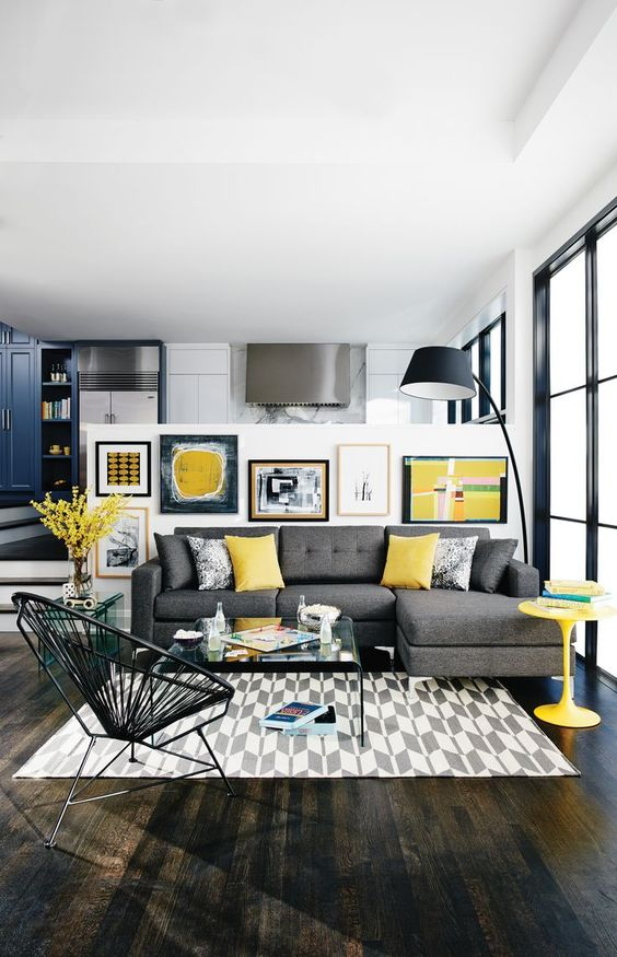 09-modern-living-room-with-a-grey-sofa-yellow-pillows-a-table-and-an-artwork